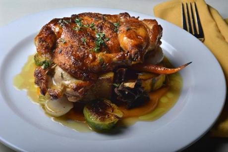 Cumin and maple roasted Cornish hen with fall vegetables.